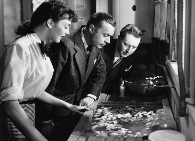 Jennifer Jones, Charles Boyer, and Reginald Gardner looking at...actually, I don't want to know what they're looking at