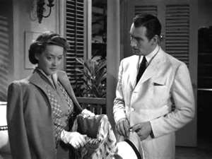 Bette Davis, lace in hand, with James Stephenson