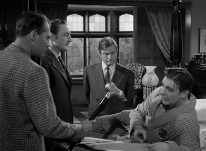Ralph Bellamy, Warren William, Claude Rains and Lon Chaney Jr. all look at the silver wolf's head cane