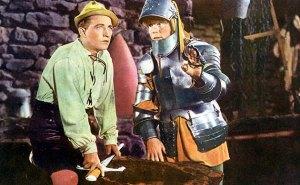 Bing Crosby at his blacksmith's ship, sharpening a sward with William Bendix