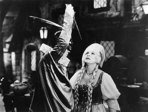 Boris Karloff is pretending to sing and  wielding his knife in the fake opera