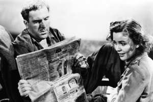 Gus (William Bendix) and Alice (Mary Anderson) read a newspaper with an ad featuring Alfred Hitchcock