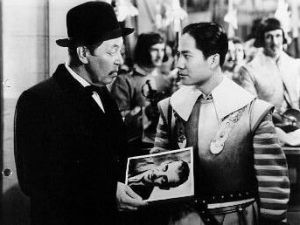 Warner Oland and Keye Luke