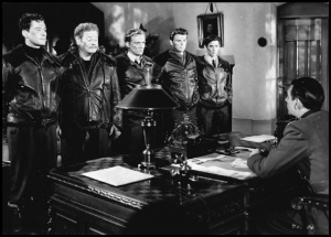 Errol Flynn, Alan Hale, Arthur Kennedy, Ronald Reagan, and Ronald Sinclair - that is Raymond Massey's head