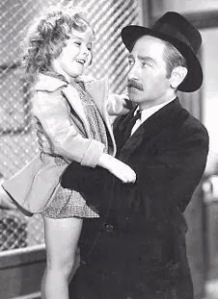 Shirley Temple and Adolphe Menjou in Little Miss Marker - the movie was a Temple vehicle and ironically is not especially close to Runyon's original story. The premise, that a man leaves his daughter at Sorrowful's place as a marker for a bet he wishes to place, but never comes back to claim her. Sorrowful is aptly named, but the child steals his heart and the hearts of all the gangsters on the street and soon Sorrowful is