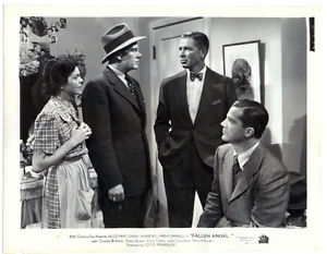 Murder suspects - the landlady looks on as Charles Bickford, Bruce Cabot and Dana Andrews warily check each other out