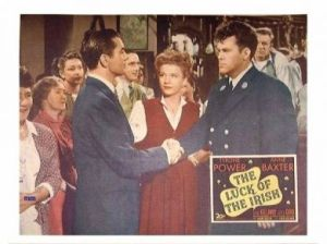 Tyrone Power and Anne Baxter with an Irish fireman in New York