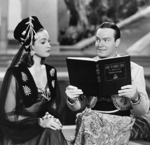 "Bob Hope is reading a book called ""How to Make Love"" in preparation for his wedding"