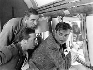 Horton, Howard and Colman look out the window of their plane and wonder where they are going