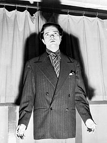 Orson Welles, after the broadcast, caught in an apologetic attitude by a photographer