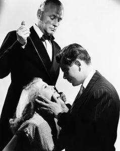 George Macready. Rita Hayworth and Glenn Ford