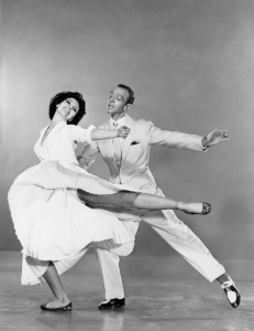 1953: Fred Astaire (1899 - 1987) and Cyd Charisse perform a dance routine in the film 'The Band Wagon', directed by Vincente Minnelli for MGM.