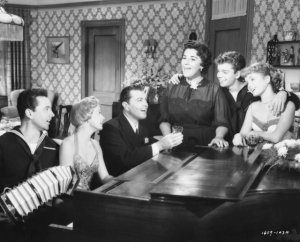 The entire cast at Rico's home, where his mother leads the singing