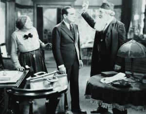 Warner Oland shows Al Jolson the door while Eugenue